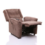 Rise and recline chair, fully reclined. A recliner chair with electric remote controlled rise and recline movement. Also called lift and tilt. Shown here in the Stock Photo