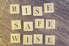 Rise Safe Wise message formed with wooden blocks Stock Photo