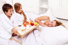 Rise and shine - breakfast in bed for mom Stock Photos