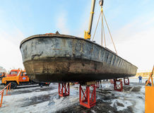 Rise of the vessel from the river on a winter shore park. Royalty Free Stock Photos