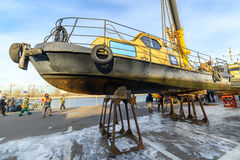 Rise of the vessel from the river on a winter shore park. Royalty Free Stock Photography