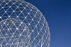 The Rise white concentric metallic spheres against uniform blue sky. The Rise spheres sculpture in Belfast royalty free stock images