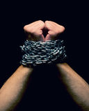 Rised up chained hands Royalty Free Stock Photography