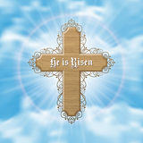 He is risen. Easter greeting card with wood cross and sun rays in the cloudy sky. Vector Illustration Stock Image