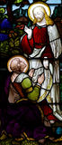 Risen Jesus with Mary Magdalene. A stained glass photo of Jesus and Mary Magdalene stock photos