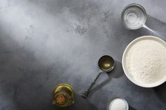 Risen or proved yeast dough for bread or pizza on a floured slate surface. Top view royalty free stock photography