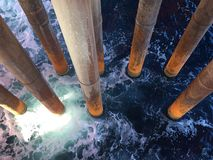 Risers. A top view shot of riser pipelines taken at an offshore installation Royalty Free Stock Image