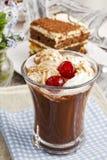 Rish coffee with cherries and tiramisu cake Royalty Free Stock Photos