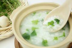 Rishavregröt med de sju örterna, japansk mat Arkivfoto