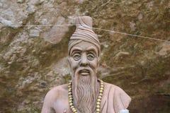 Rishi. Close up Rishi statue with stone background royalty free stock images
