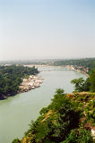 Rishikesh and the Ganges river, India. Rishikesh, the holy city for the Hindus and the holy Ganages river that flows through it, India royalty free stock photo