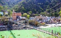RISHIKESH, INDIA - April 03, 2014 - The main view to Ganga river, bridge and temple. stock image