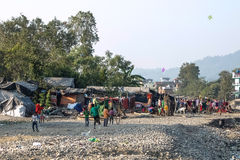 Poor children playing in slums near Rishikesh, India stock photo