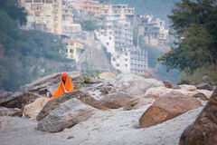 RISHIKESH, INDIA - JAN 05: An unidentified baba meditating on ro Royalty Free Stock Images