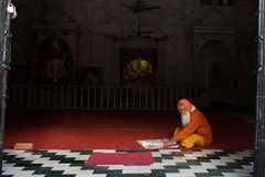 RISHIKESH, INDIA - JAN 05: An unidentified baba reading paper in Royalty Free Stock Image