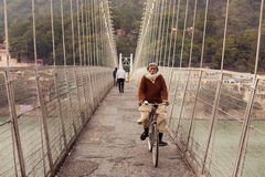 RISHIKESH, INDIA - JAN 02: An unidentified man on the bike cross Royalty Free Stock Photography