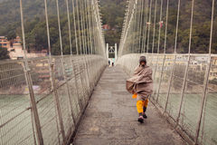 RISHIKESH, INDIA - JAN 02: An unidentified old man walking on th Stock Photo