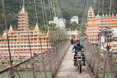 RISHIKESH, INDIA - JAN 02: An unidentified tourist on the bike o Stock Images