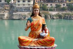 Statue of sitting goddess Parvati on the riverbank of Ganga in Rishikesh Stock Photography