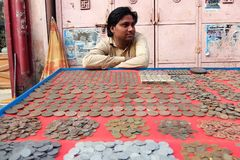 Man selling old coins on the street of Rishikesh Stock Images