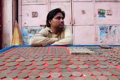 Man selling old coins on the street of Rishikesh Royalty Free Stock Photo