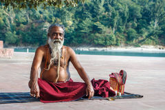 Rishikesh, INDIA November 2012: Unidentified sadhu - holy man - on the ghats of Ganges. Rishikesh is the holy sacred Royalty Free Stock Image