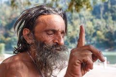 Rishikesh, INDIA November 2012: Unidentified sadhu - holy man - on the ghats of Ganges. Rishikesh is the holy sacred Royalty Free Stock Photo