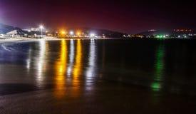 Rishikonda Beach at night with city lights and hills Stock Photos