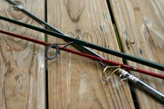 Rishing rods. Fishing rods with fishing line on wood dock stock photos