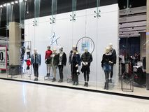 RISHON LE ZION, ISRAEL- DECEMBER 17, 2017: Luxury and fashionable brand window display. Casual clothing and bag showcase in front of the store Stock Image