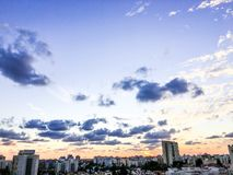 RISHON LE ZION, ISRAEL-NOVEMBER 1, 2017: An amazing dramatic cloudy sunset over the city and a beautiful dramatic sky with clouds royalty free stock images