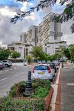 High rising towers over the 3 stories houses in Rishon LeTsiyon stock image