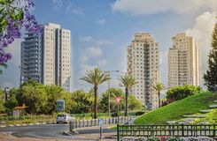 Ha-Tkuma Street in summer morning. Rishon LeZion, Israel-June 17, 2017: Junction of two streets Ha-Tkuma with Golda Meir on saturday summer morning. One car Royalty Free Stock Images