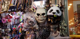 Scary masks and other plastic colorful stuff for children exposed for sale in a shop before jewish purim masquerade stock photos