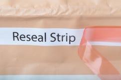 Risigilli la striscia sull'imballaggio per alimenti Fotografie Stock Libere da Diritti