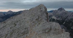Rising above mountain ridge towards the top. stock video