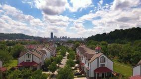 Rising Aerial Establishing Shot of Harrs Island and Pittsburgh Skyline. 8755 A rising aerial establishing shot of the upscale residential homes on Washington`s stock video