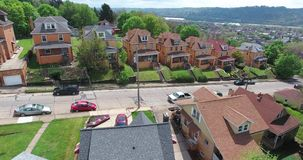 Rising Aerial View Typical Pennsylvania Neighborhood. A rising aerial view of Ambridge, Pennsylvania, a small town just north of Pittsburgh stock footage