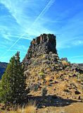 Rising Into the Blue. Chimney Rock in the Crooked River Canyon south of Prineville, OR royalty free stock photos