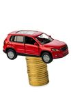 Rising car costs. car on coins. Rising costs in the car by workshop costs royalty free stock photos