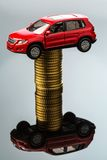 Rising car costs. car on coins. Increasing costs for the car through workshop costs royalty free stock photography