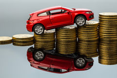 Rising car costs. car on coins Stock Images