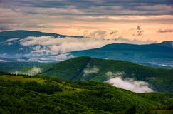 Rising clouds above the mountain ridge. Gorgeous springtime scenery at sunrise Royalty Free Stock Image