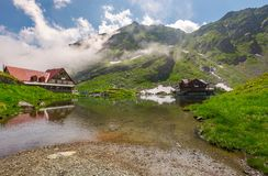 Rising clouds on lake balea. Beautiful summer landscape of popular tourist attraction. one of the most visited locations near the Tranfagarasan road stock photography