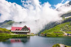 Rising clouds on lake balea. Fagaras mountains, Romania - Jun 26, 2017: rising clouds on lake Balea. beautiful summer landscape of popular tourist attraction Royalty Free Stock Images