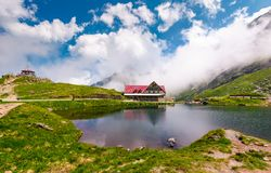 Rising clouds on lake balea. Fagaras mountains, Romania - Jun 26, 2017: rising clouds on lake Balea. beautiful summer landscape of popular tourist attraction Stock Photography