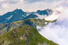 Rising clouds over the Fagaras mountains. Of Romania. gorgeous nature scenery on high latitude in summertime royalty free stock images