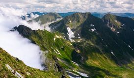 Rising clouds over the Fagaras mountains. Of Romania. gorgeous nature scenery on high latitude in summertime royalty free stock image