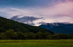 Rising clouds in valley at dawn Royalty Free Stock Photos