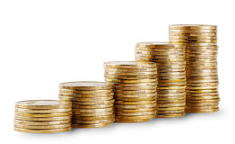 Rising columns of golden coins Royalty Free Stock Images
